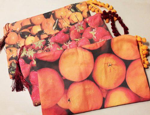 Diseño frutos naranjas con asas y pasamaneria